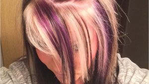 Blonde Hairstyles with Red Underneath Purple Blonde and Black On top with All Black Underneath