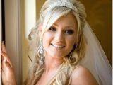 Bride Hairstyles Half Up with Tiara Bride with Wavy Hair and Tiara Wedding Hairstyles