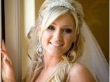 Half Up Bridal Hairstyles with Veil Bride with Wavy Hair and Tiara Wedding Hairstyles
