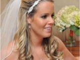 Half Up Bridal Hairstyles with Veil Wedding Hair Half Up with Flower and Veil Wedding Diary