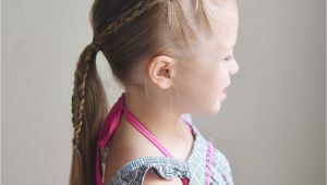 Little Girl Cheer Hairstyles Elastics and Braids Into A Ponytail Teswood Q S Hairdos
